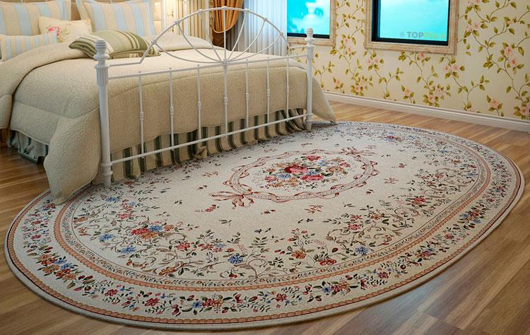 большой овальный ковер в спальне
